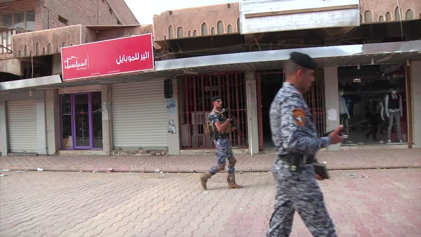 CIRCA 2010s - U.S. troops and Iraqi officials walk through the town of Samarra, Iraq.