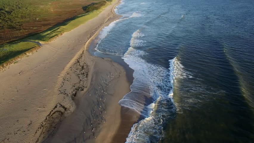 Aerial shot on the Cape Cod Coast with waves. - 4K stock video clip