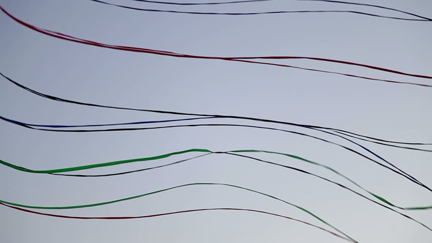 a line of kites attached together flying in the air  - HD stock footage clip