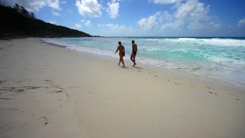 People Walking On Sandy Beach Stock Footage Video 1349398 ...