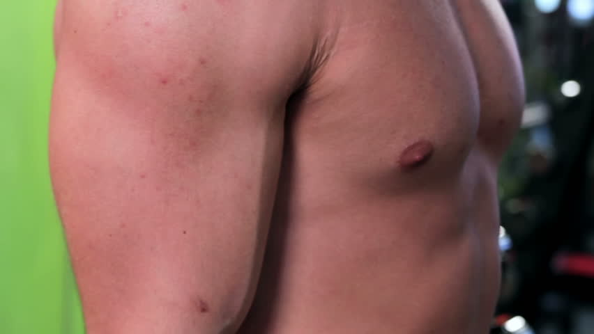 Workout for young bodybuilder. Man doing exercise for biceps with dumbbells closeup