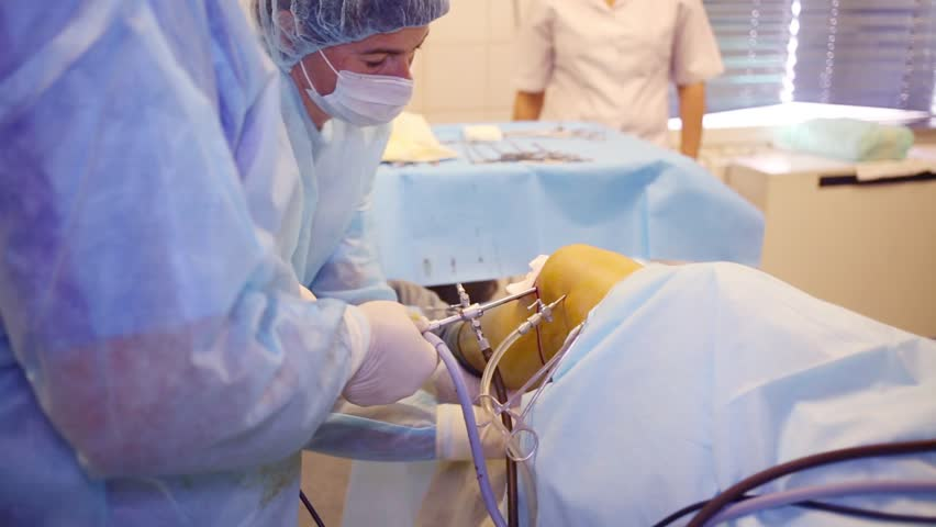 MOSCOW - SEP 1, 2015: Preparing for endoscopy surgery of knee in Center of endosurgical and lithotripsy