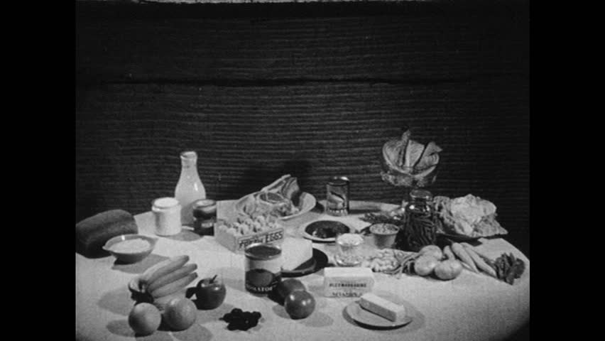 UNITED STATES 1940s: Food on table / Boys play baseball / Girls play basketball / Boy reading book / Girl writes at desk.