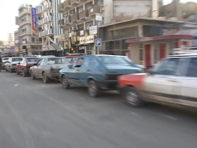 IRAQ - CIRCA 2003: Cars wait in long lines for gas circa 2003 in Baghdad, Iraq.