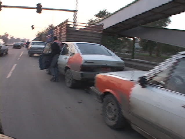 Iraqis push their cars while they wait for gas in Baghdad.