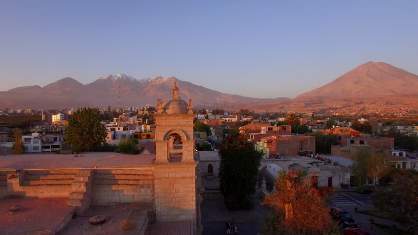 Arequipa volcano at sunset, church in the foreground