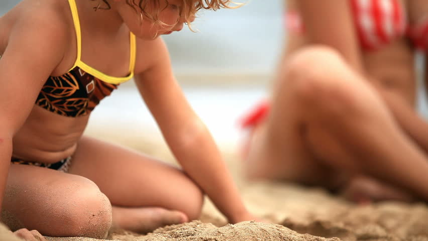 A little girl playing at the beach.  - HD stock footage clip