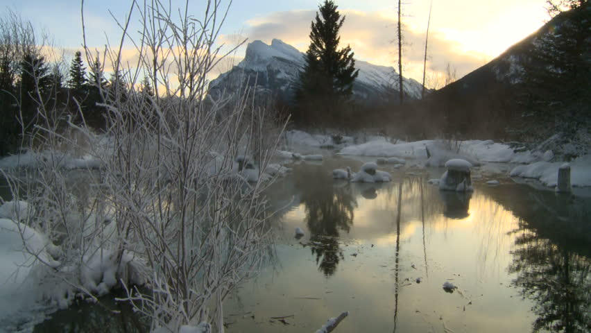 warm spring in winter with Mt Rundle, Banff