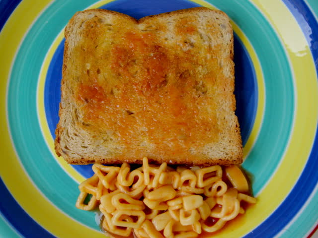 shut up and dance written with alphabetti spaghetti letters on toast