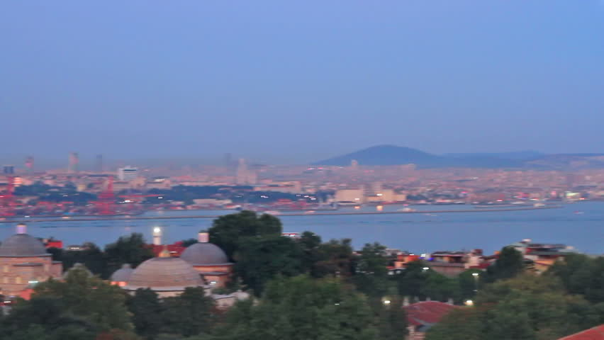 Istanbul with amazing Mosques; Pan from Blue Mosque to Hagia Sophia  - HD stock footage clip