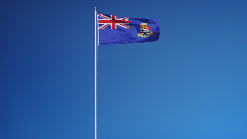 Cayman Islands flag waving in slow motion against blue sky, seamlessly looped, long shot, isolated on alpha channel with black and white luminance matte, perfect for film, news, digital composition