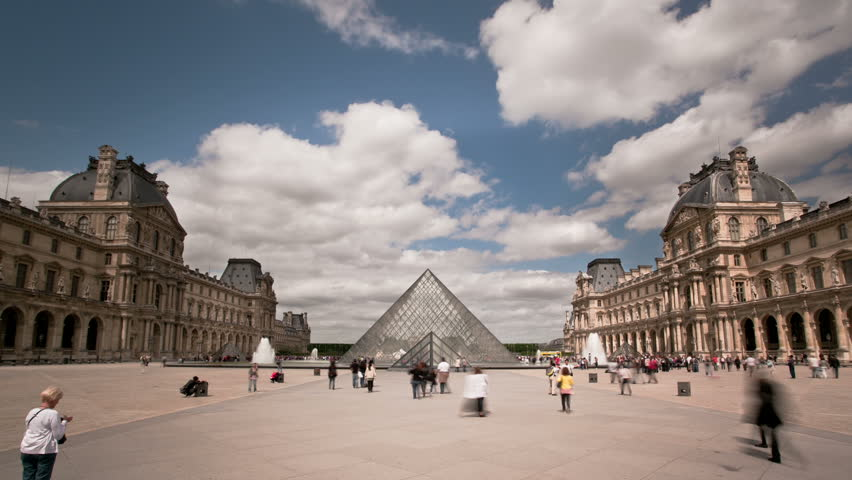 PARIS - JUNE- 2011: Timelapsed Louvre Pyramid
