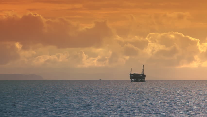 Ocean Sunset - Oil Rig Drilling Platforms on Horizon - HD stock footage clip