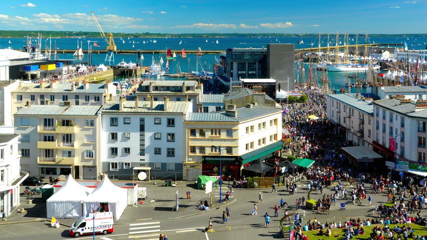 Brest, France - July 14, 2016: Cinemagraph on the Brest International Maritime Festival in summer 2016 - Timelapse above the swarming crowd - old rigging and ships.