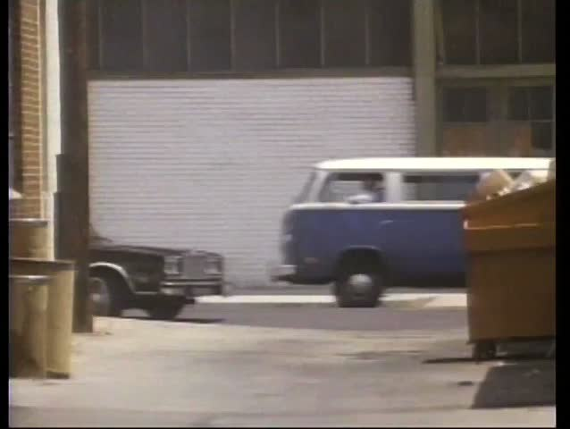 Car chase through back alley