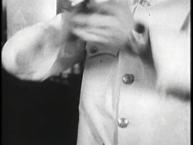 Close- up of hands mixing drink in cocktail shaker