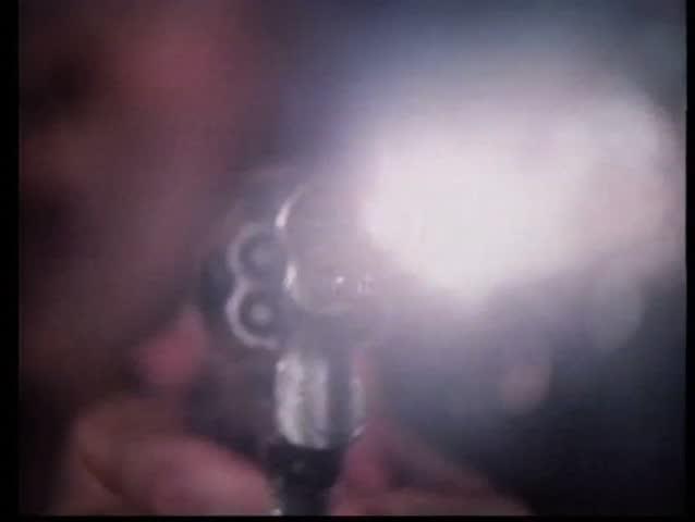 Close-up of gun barrel firing