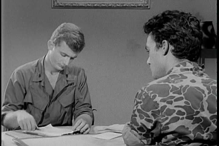 Utilizing the direct approach, a United States Army interrogator finishes his interrogation of an enemy soldier in a Latin American country on a friendly note in 1968. (1960s)