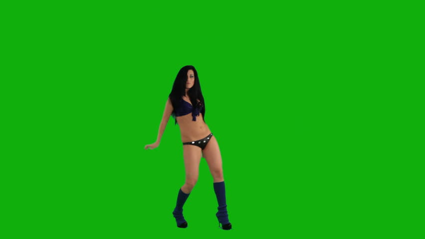Beautiful young girl dancing against green screen  - HD stock footage clip