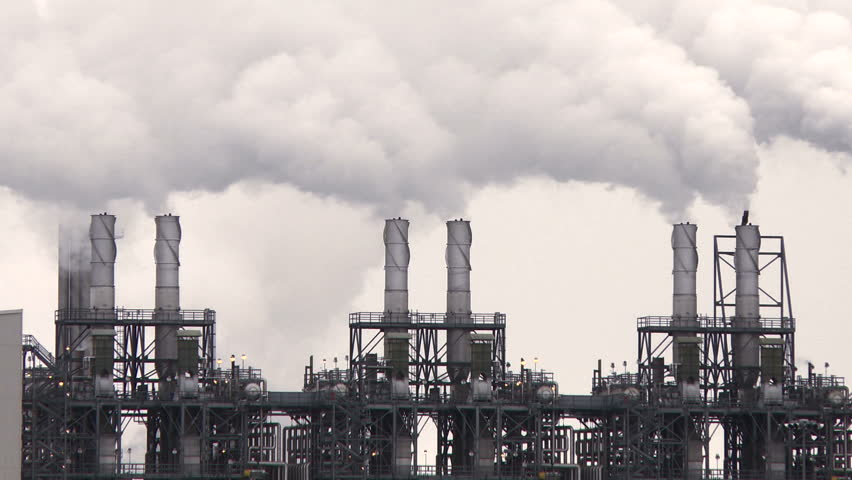 Smoke stacks of petroleum and petro chemical industry refineries