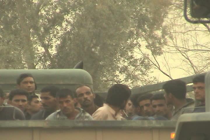BAGHDAD, IRAQ - CIRCA 5/21/03: Iraqi detainees being transported in trucks at Abu Ghraib.