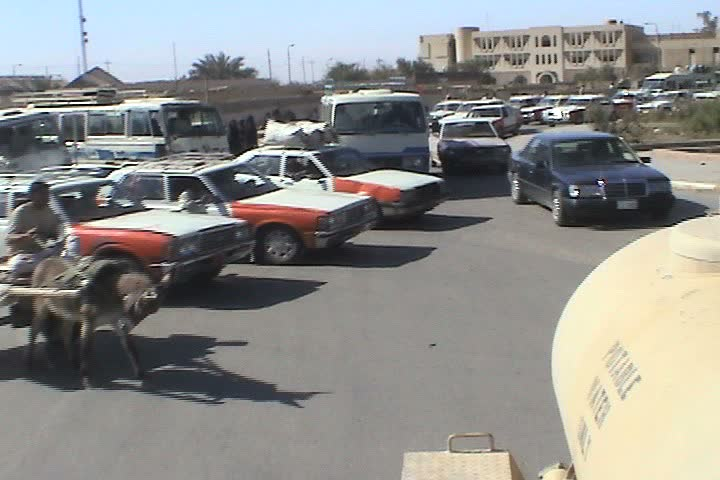 IRAQ - CIRCA 5/1/03: Iraqis use donkey carts for transportation.