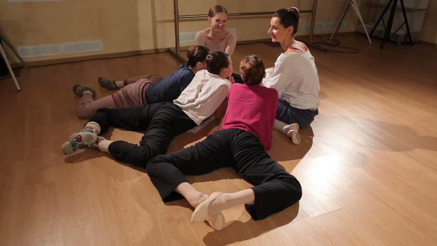 Ballerinas sitting on the floor in a dance class stock for Dance where you sit on the floor