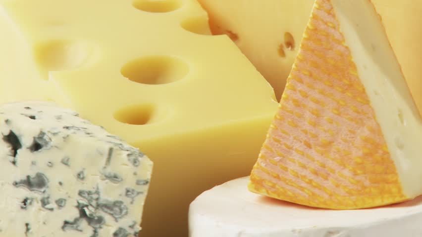 Pieces of different cheeses on plate