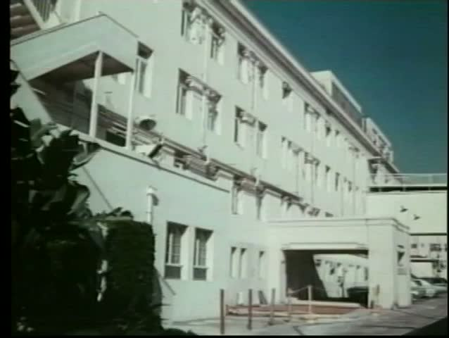 Establishing shot of white low-rise building - SD stock footage clip