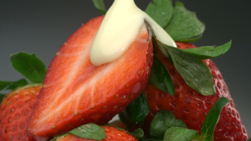 Close-up white chocolate over strawberries - HD stock footage clip