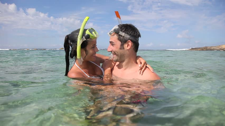 Happy couple with snorkeling outfit