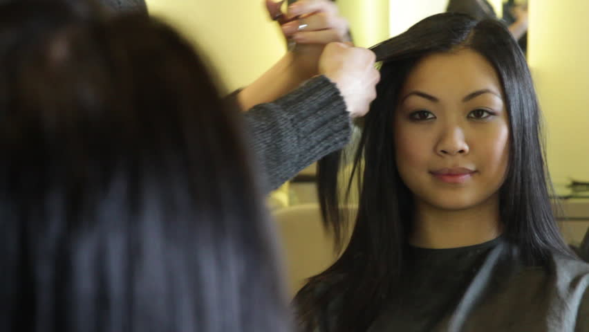 MEDIUM SHOT, Hairstylist, cutting hair of female customer - HD stock footage clip