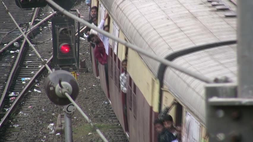 MUMBAI - APRIL 19: A train leaves the station in Mumbai, India