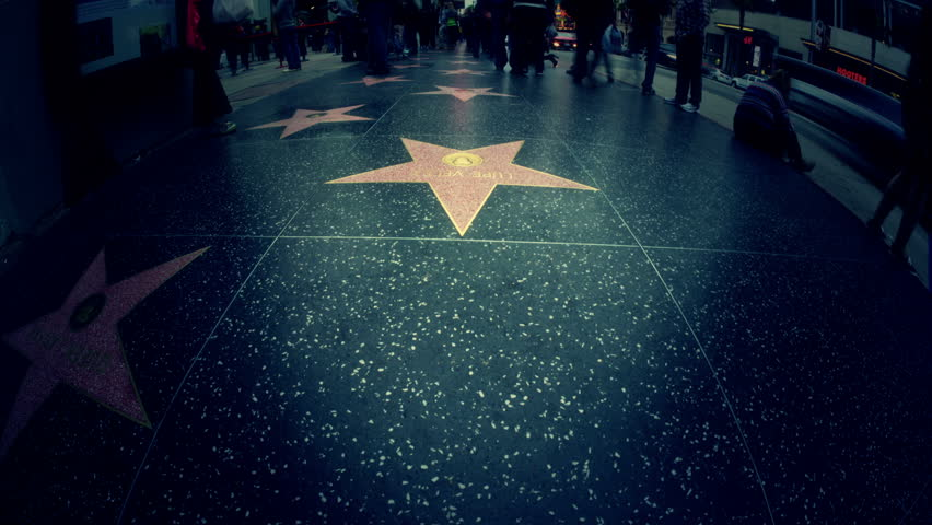 LOS ANGELES, CA - APRIL 23: (Timelapse View) POV walking on Hollywood Walk of Fame stars on April 23, 2012 in Los Angeles. Hollywood Walk of Fame is an international tourist attraction in LA.