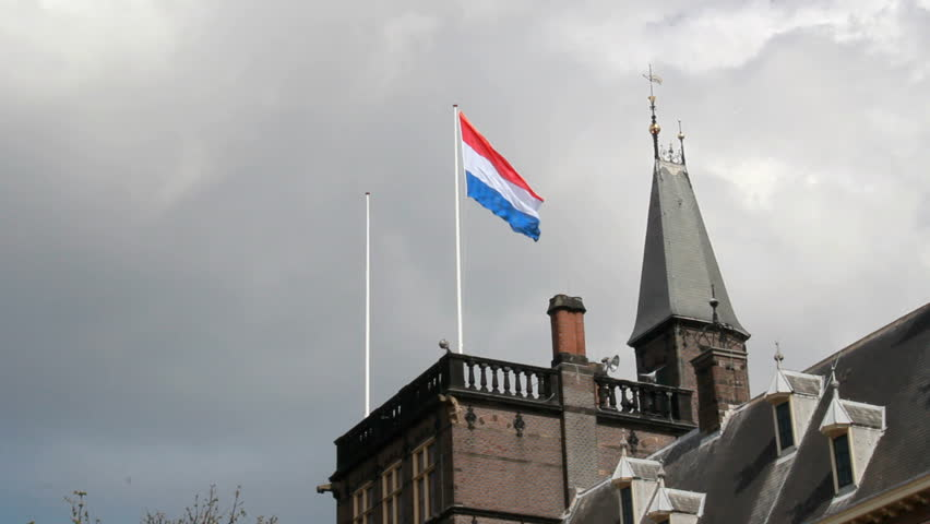Dutch Flag flying on the Binnenhof Parliament on Queen's Day in The Hague, Holland - HD stock footage clip