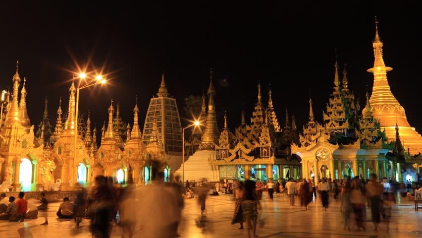 YANGON, MYANMAR- APRIL 15 : People visit the Shwedagon Pagoda on April 15, 2012.  Shwedagon Pagoda is the most sacred Buddhist pagoda for the Burmese.