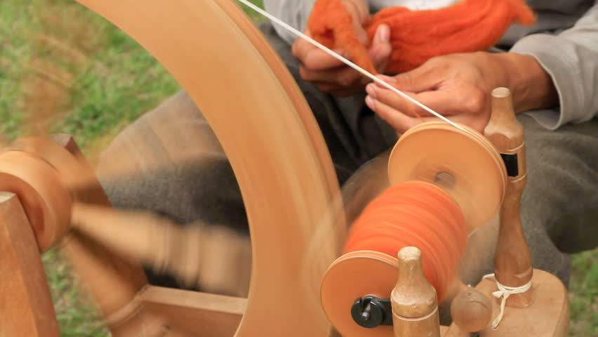 Spinning woolen yarn.