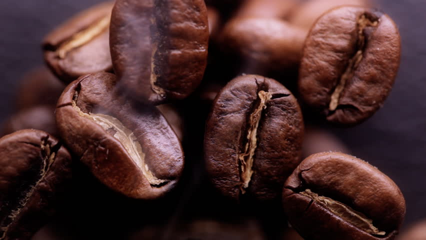 Fragrant fried coffee bean with the smoke  - HD stock footage clip