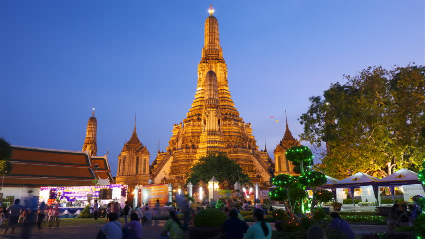 BANGKOK - APRIL 15: (Timelapse in motion view) Many tourists near Wat Arun temple on April 15, 2012 in Bangkok, Thailand.