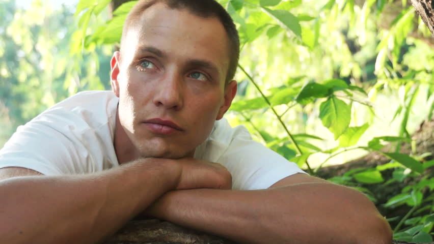 Young man dreaming outdoors - HD stock video clip