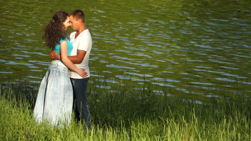 Loving couple near the water - HD stock footage clip