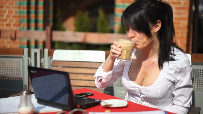 Beautiful business woman working in cafe - HD stock video clip