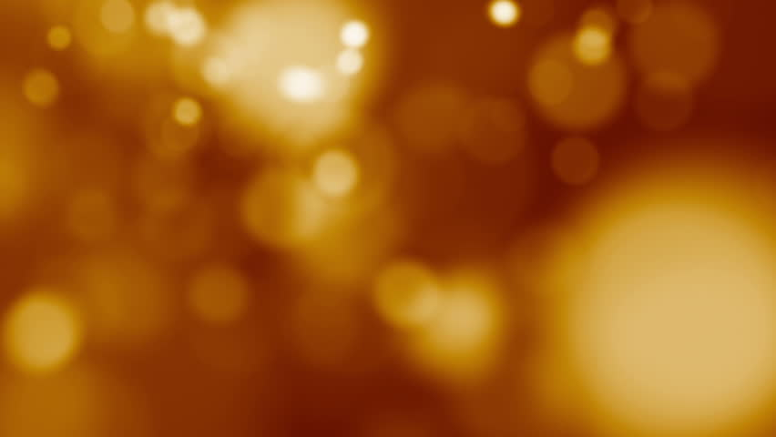 Abstract bokeh golden particles - HD stock footage clip