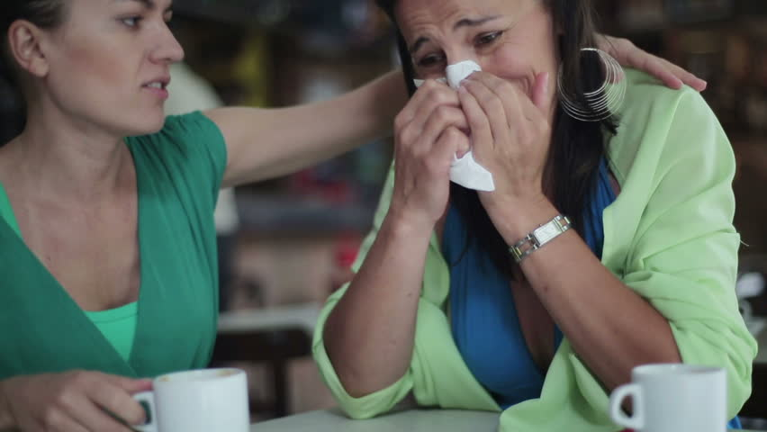 Female friend comforting sad woman in the restaurant, steadycam - HD stock footage clip
