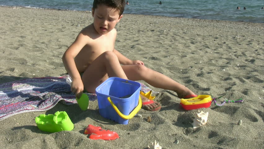 Little boy playing at the beach - HD stock video clip