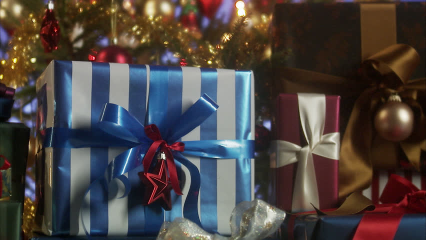 Presents by a Christmas tree.