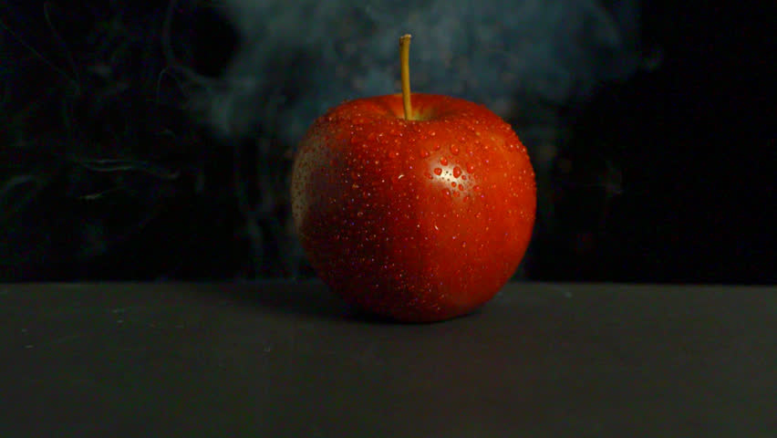 An apple exploding, close-up.