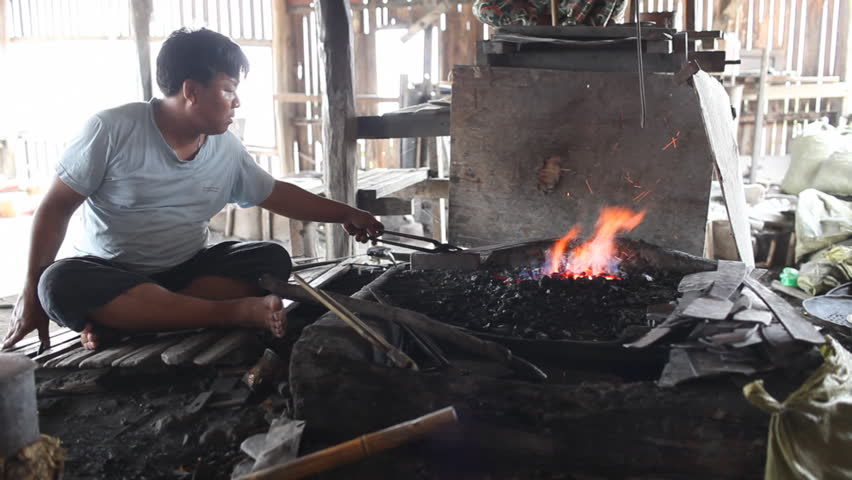 INLE LAKE, MYANMAR - APRIL 20: People work in blacksmith's shop on April 20, 2012 on Inle lake, Myanmar. Inle lake isone of  the most popular place to visit in Myanmar.