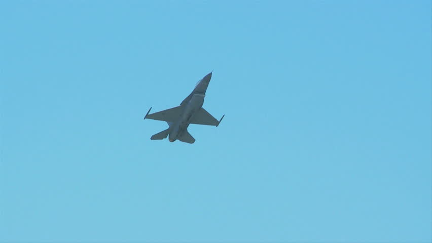 QUONSET, RHODE ISLAND - JUNE 2012: Air force F-16 Falcon flying directly overhead at the Rhode Island National Guard Open House and Air Show in June 2012.