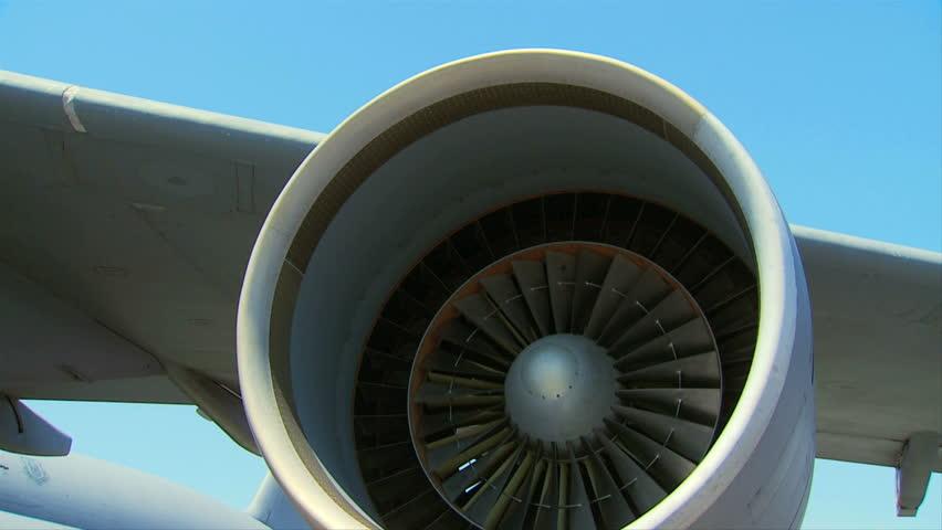 Large jet engine turbine blades slowly turning